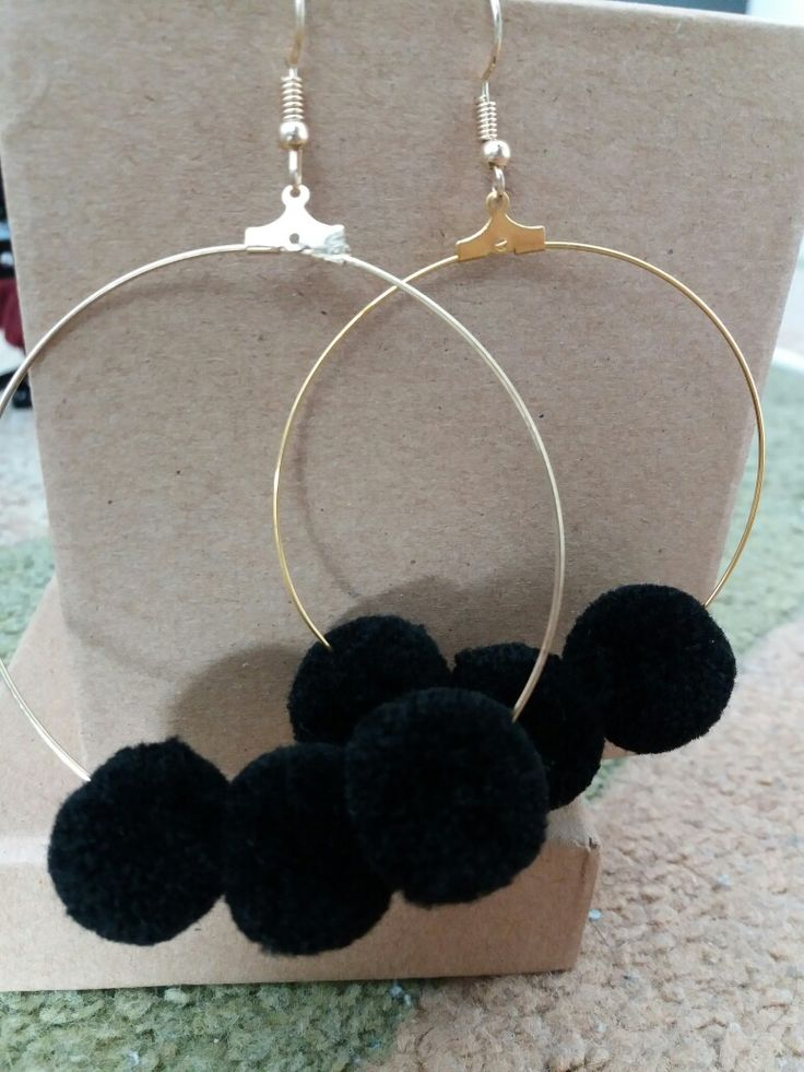 Earrings with ppm poms