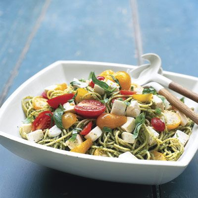 Get dinner on the table faster by whipping up an easy homemade pesto while the spaghetti for this tomato and mozzarella salad boils. Click through for the recipe and more pasta salads that are perfect for summer dinners.