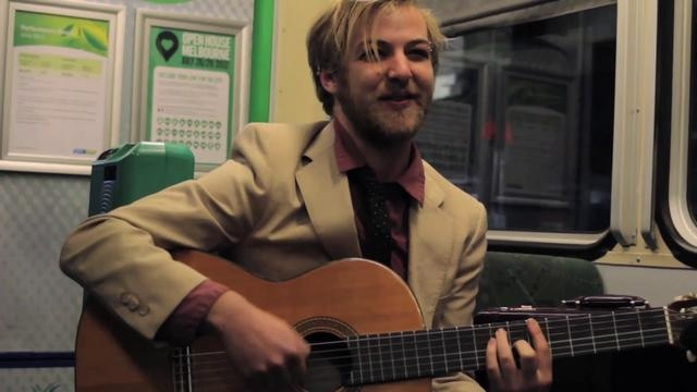 """Tom Dickins - Modern Day 'Ole Fashion Man by Tram Sessions. With ukulele, guitar and briefcase in tow, the """"heartbreakingly hilarious king of indie cabaret"""", Tom Dickins, drew a great crowd on the Monday night 112 tram as part of The Melbourne Cabaret Festival."""