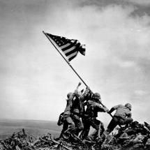 Raising the Flag on Iwo Jima is a historic photograph taken on February 23, 1945, by Joe Rosenthal; Posted by: EmilyDawn2