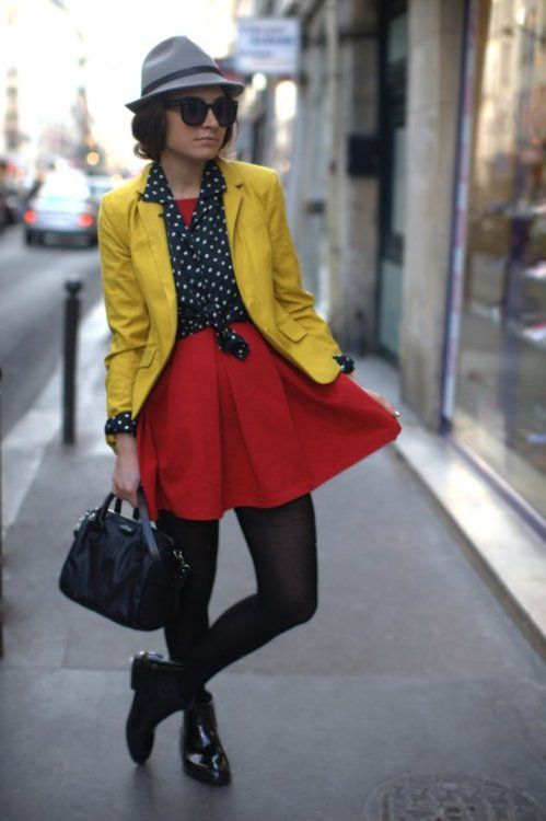 This outfit shows the primary colors and that how well they go together. The hat is a light blue color, the dress is a dark red and the coat is a mustard yellow!