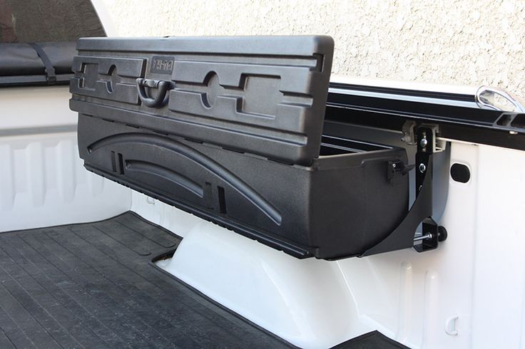 The DU-HA Humpstor mounts above the wheel well in pickup truck beds and fits underneath most toppers, tonneaus, and roll up covers.