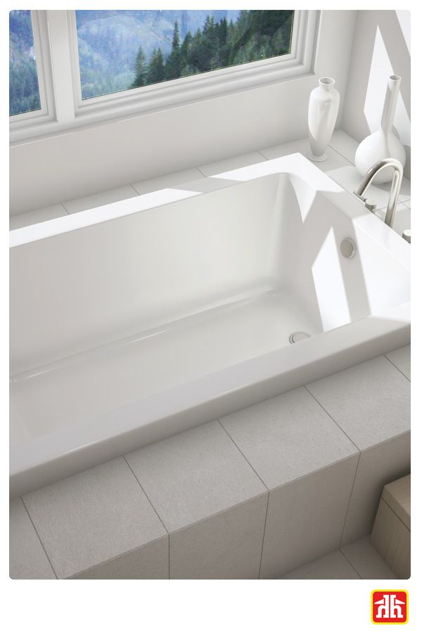 A bathroom turns into a spa with this soaker bathtub. The perfect place to relax, read a book and enjoy a glass of wine.