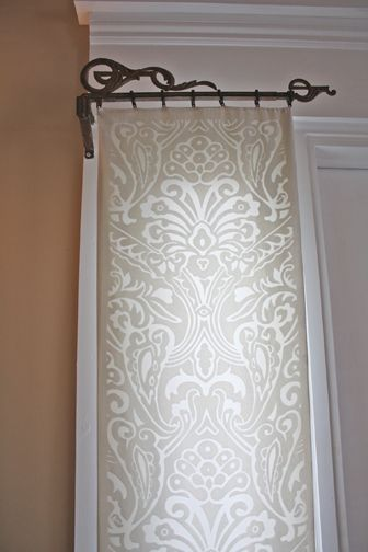 Metal Scrollwork Drapery Rods Hold A Length Of Ivory
