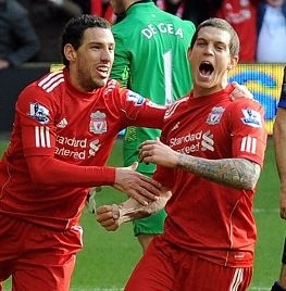 Agger celebrating after scoring against Man U in FA Cup 4th Round. Liverpool won 2-1