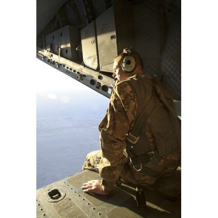 US Air Force Commander sits harnessed on the back ramp of an Afghan Air Force C-27 Spartan Canvas Art - Stocktrek Images (23 x 34)