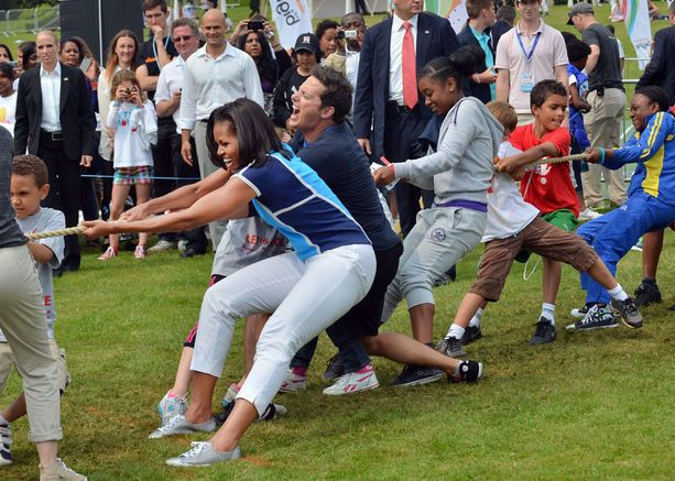 First Lady Michelle Obama plays tug-of-war during 'Let's Move-London' event at the Winfield House in London hours before the start of the London 2012 Olympic Games.