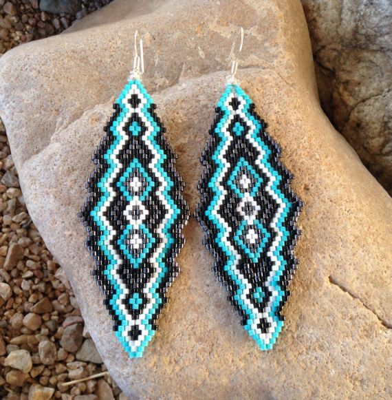 These earrings are beautiful in contrasting colors done in Turquoise, Black, Gunmetal and White glass Delica beads in a Peyote Stitch. Very light weight. These southwest earrings are 3.5 long and 1 1/4 wide with french hooks. They would make a great gift or treat for yourself.