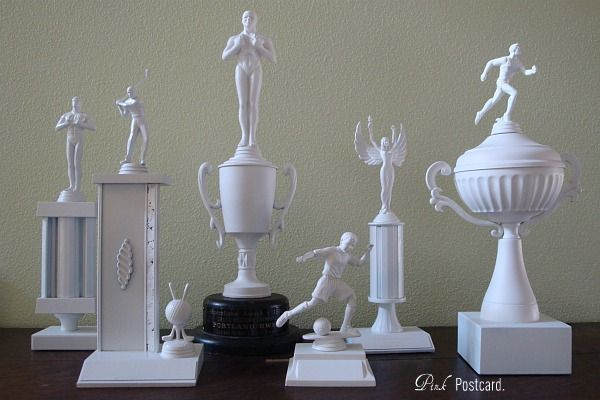 Old trophies? Turn them into modern art with white paint! #upcycle #diy