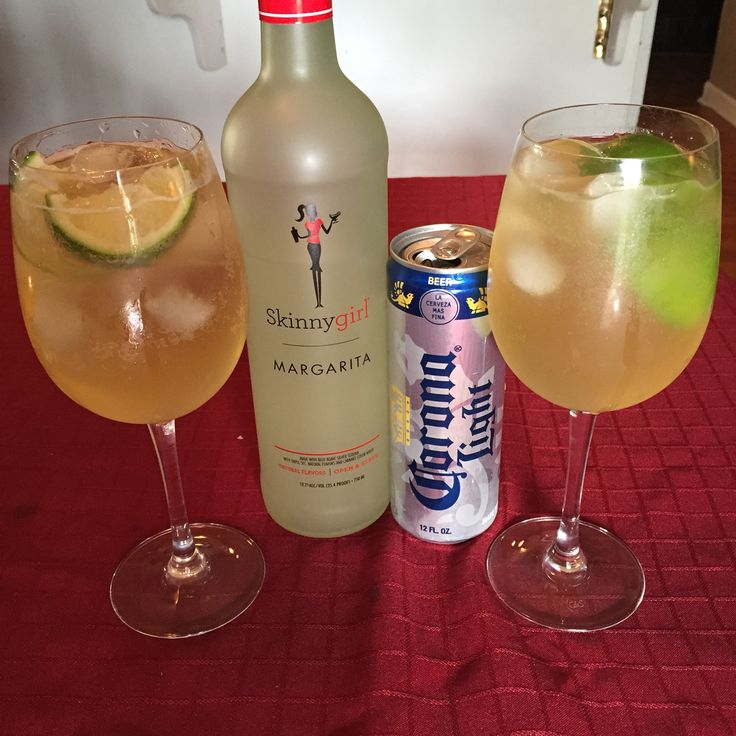 Skinny Beergaritas! Two parts skinny girl margarita and one part corona light over lots of ice with lime! Yummy low calorie cocktail for summer.