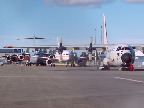 Line up of Antarctic aircraft. USAF LC-130, Australian Antarctic Division A319 and USAF C-17  Type: Lockheed LC-130H, Airbus A319-115LR, Boeing C-17A  Location: Christchurch International Airport  Date: 25/10/2010