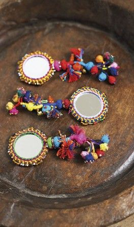 pompoms for mirrors...For more ethnic style and tribal fashion visit: http://www.wandering-threads.com/