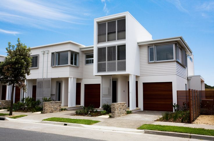 Making a statement with large, cantilevered windows. Bright and modern at Rockpool Terraces featuring #Scyon™ #Linea™ #weatherboard. #architecture #design #house #home #terrace #exterior
