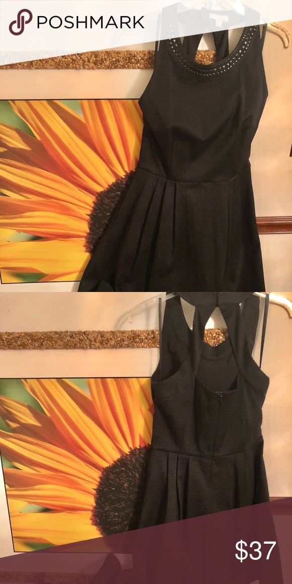 New York &Company Lil Black Dress❤️ Women Elegant Lil black dress with pockets, A-Line, embellishments around front of neckline, sleeveless, snaps and zips in back with a cute cut out. Cute for date night. Enjoy ❤️ New York & Company Dresses Mini