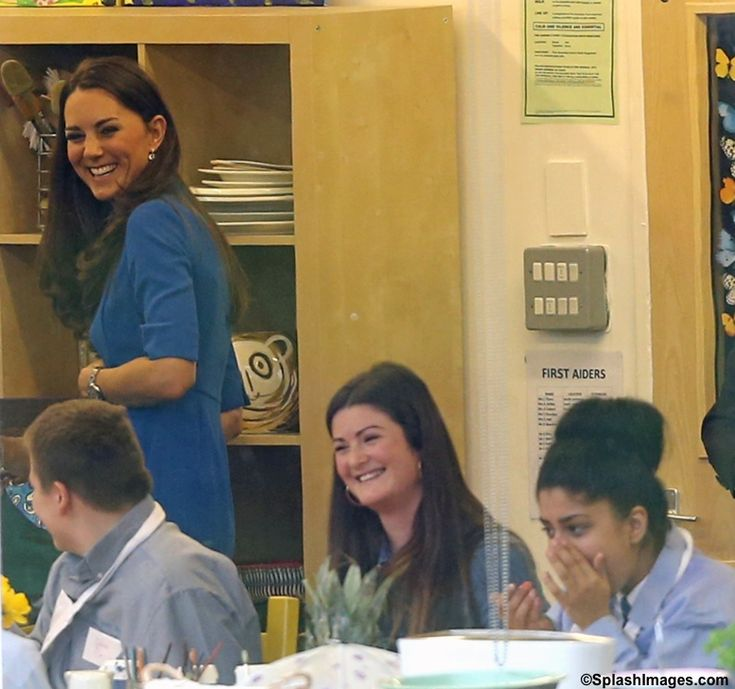 "Catherine, Duchess Of Cambridge, aka Kate Middleton, attending The ICAP Art Room Opening At Northolt High School in west London. She is wearing LK Bennett's ""Detroit style"" dress in ""snorkel blue,"" a new watch from Cartier, part of the jeweler's Ballon de Bleu collection, the Stainless Steel version, her Mappin & Webb Fortune White Gold Drop Pendant, and earrings from Kiki McDonough. 02/14/14"