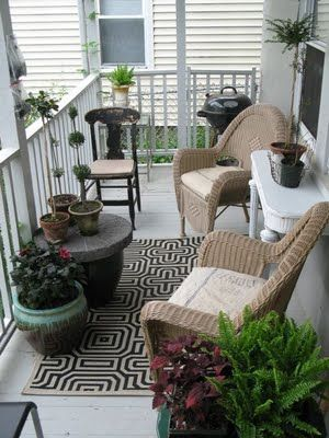 Table against the window and planter under the mailbox next to front door