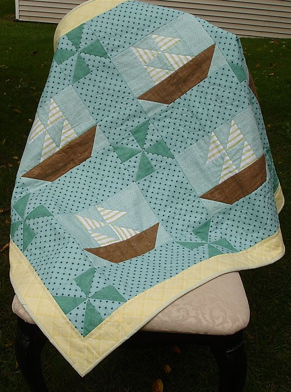 Cute sailboat quilt. I think the pinwheels and quilted waves are my favorite parts. For my next grandson....hmmm...who is next....