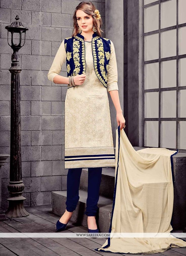 Look sensationally awesome in this navy blue and white cotton   and jacquard silk churidar designer suit. The lovely embroidered work throughout the attire is awe inspiring. Comes with matching bottom...