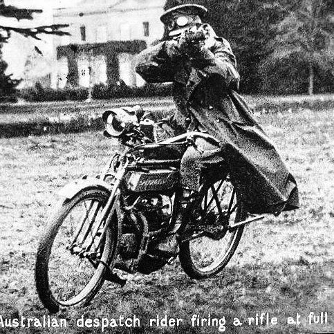 WW1 Australian despatch [dispatch] rider firing a rifle at full speed. (Source…