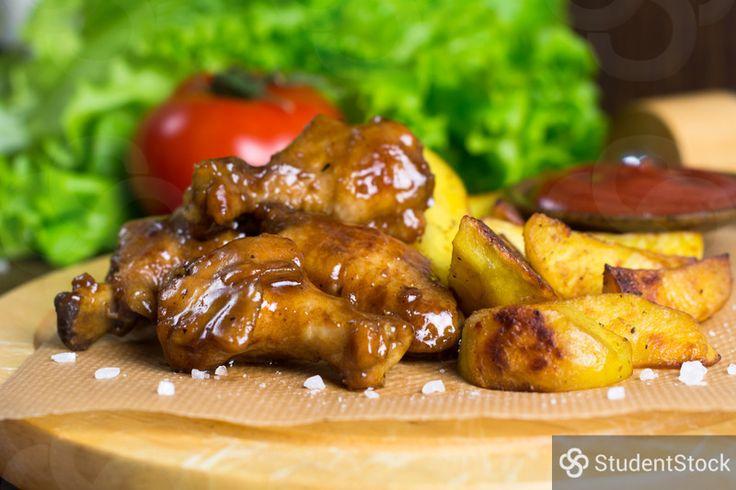 StudentStock - Teriyaki chicken wings and baked potato wedges by Vladislav Nosick