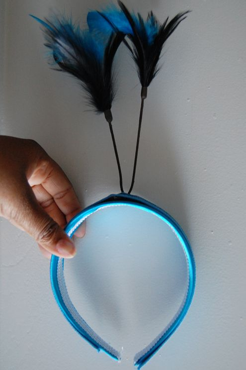 diy peacock costume from green your decor. use real peacock feathers