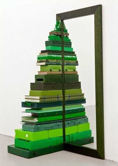 Books and mirror used for creating an alternative Christmas tree, creative and unusual Christmas decorating ideas