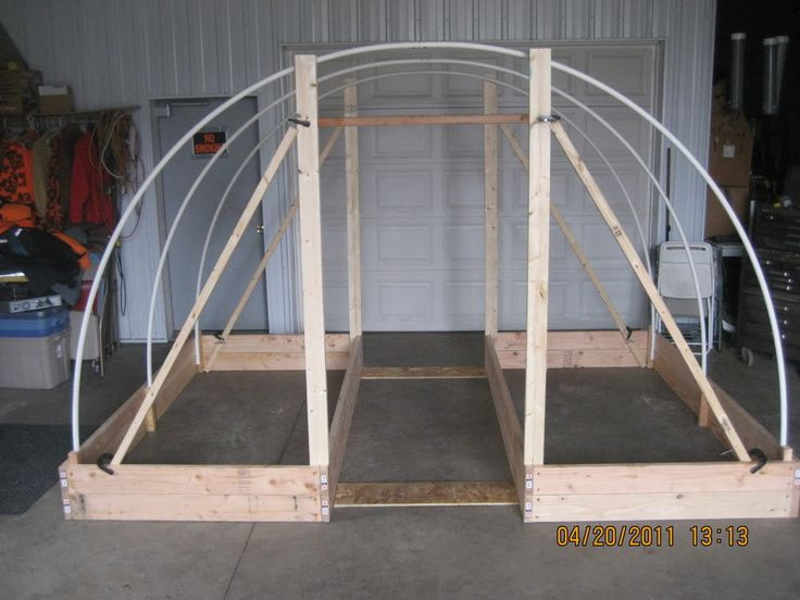 """""""double enclosed hoop house frame"""" I could easily rearrange (I have to move one to make room for the greenhouse anyway) my two large raised beds and do this. I might want to add some additional trellising. -CAB"""