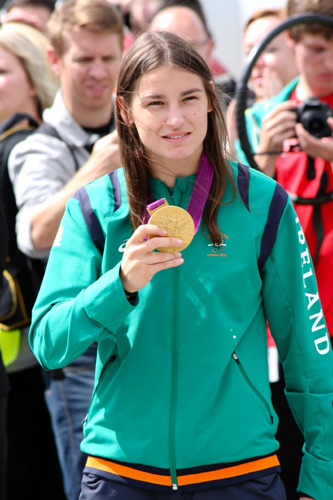 Irish boxer Katie Taylor shows off her Olympic gold medal at Dublin Airport #Teamireland #London2012 #Olympics #Ireland #KatieTaylor #Ireland #DublinAirport
