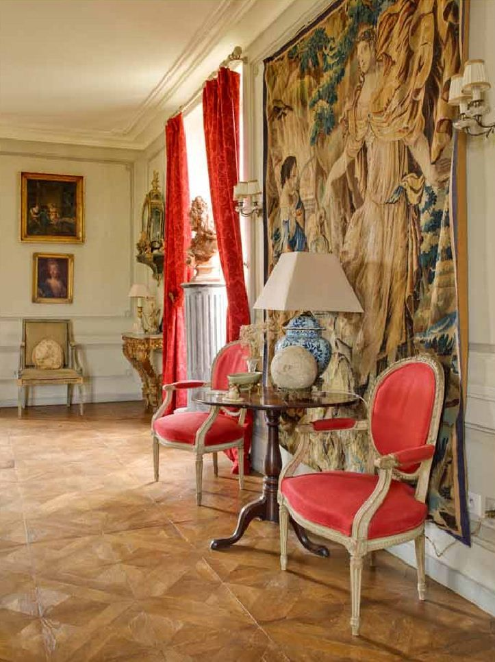 decordesignreview:  tapestry graces the wall  of this French chateau ~ David Hare design