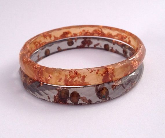 Handmade faceted eco-resin bangle in amber with copper leaf.