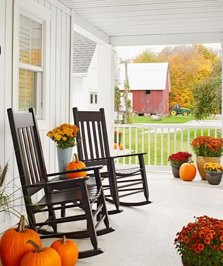 Twin rocking chairs bring classic farmhouse comfort to this Michigan porch. More photos from this home: http://www.midwestliving.com/homes/featured-homes/house-tour-dream-acres-farmhouse-michigan/?page=7
