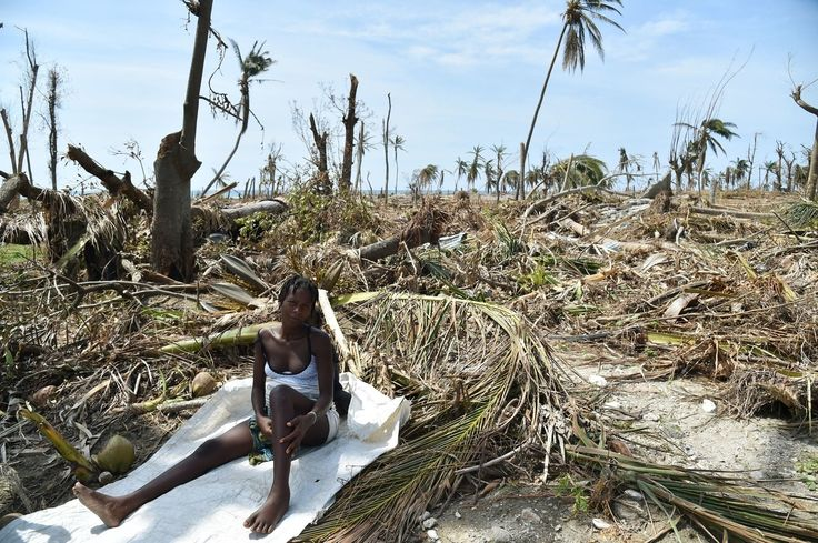 Erlande Toussaint, aged 63, sits outside her home in Kayobry which was totally destroyed by Hurricane Gustav.
