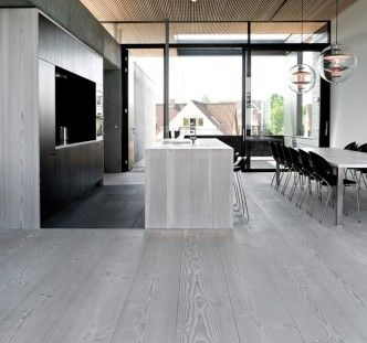 black galley kitchen, wide plank floors