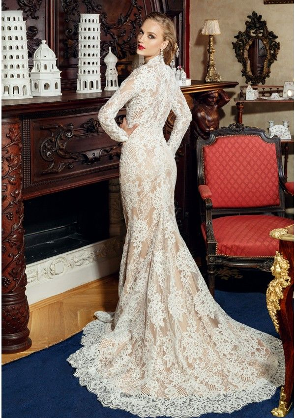 Ivory lace wedding dress and nude silk Mermaid silhouette with plunging neckline and cups included Victorian high collar inspiration Long sleeve lace Closes back zipper long train