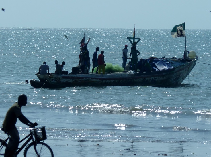 fishermen on the beach at Kololi
