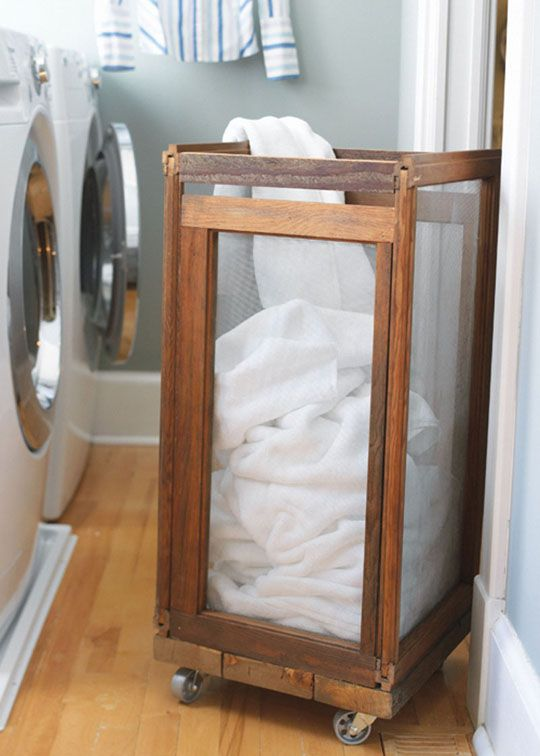 """Make a Rolling Laundry Hamper from Old Screens Country Home~ LOVE LOVE THIS!!!! lets the laundry """"breathe"""" (important with boys lol) and is on wheels so its MOBILE! GENIUS!!"""