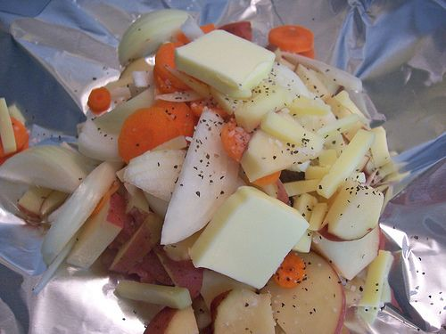 Hobo meal -      ground meat (beef or turkey)     carrots     potatoes     onions     any other veggies that would roast well (mmm, broccoli! asparagus!)     salt and pepper     butter     cheese (optional)     aluminum foil