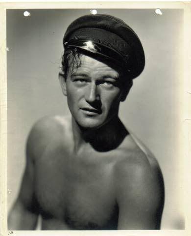 a young John Wayne, sailor