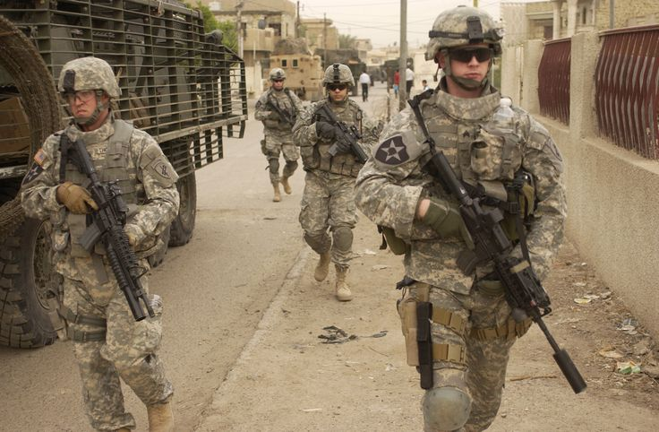 U.S. Army soldiers move down a street as they start a clearing mission in Dora, Iraq, on May 3, 2007. Soldiers from the 2nd Platoon, Alpha Company, 2nd Battalion, 3rd Infantry Regiment, 3rd Stryker Brigade Combat Team, 2nd Infantry Division are patrolling the streets in Dora. DoD photo by Spc. Elisha Dawkins, U.S. Army. (Released)