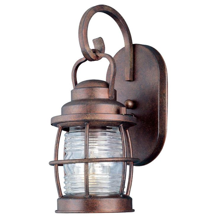 Add iconic traditional style to your outdoor decor with the eye-catching Rockledge wall lantern. Finished in a rustic weathered bronze color, this beautiful curved light features a clear ribbed glass shade.