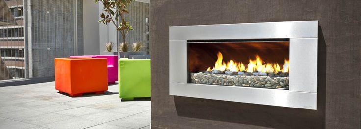 Escea outdoor EF5000 gas fireplace on the roof top with colourful outdoor furniture