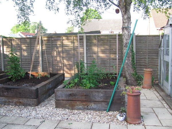 Raised beds made with old railway sleepers......hmmmmm wonder if the guys over at the railroad track could hook me up?!