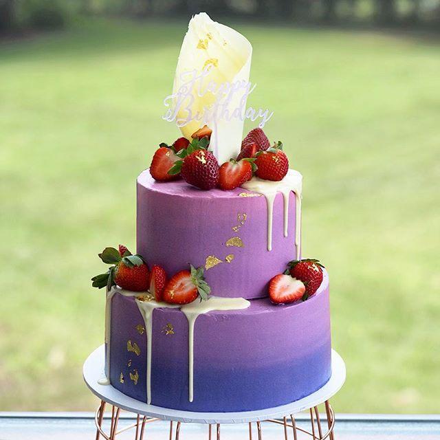 Pretty purple ombre birthday cake for Allison. Vanilla bean and browned butter vanilla buttercream. White chocolate sale and drip Yum. #strawberrycake #ombrecake #birthdaycake #vanillabean #weddingcake #buttercreamcake #smbc