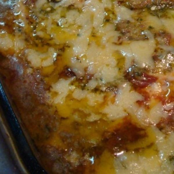 Receita de Lasanha de Berinjela Empanada - 500 ml de molho de tomate, 500 gr de mussarela, 500 gr de presunto magro, 2 unidades de ovo batidos com uma colhe...