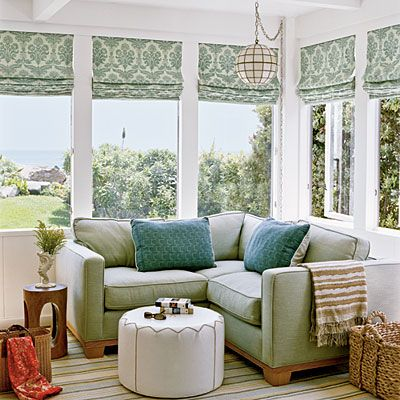 Cozy Corner    This custom sectional piece in a soothing moss green hue fits snugly into a window-filled corner of this room. A stylish large-scale pattern like this traditional damask lends a feeling of warmth to any room.