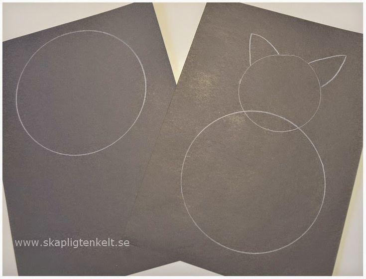 En svart katt av papper. Pyssel. Papperspyssel.