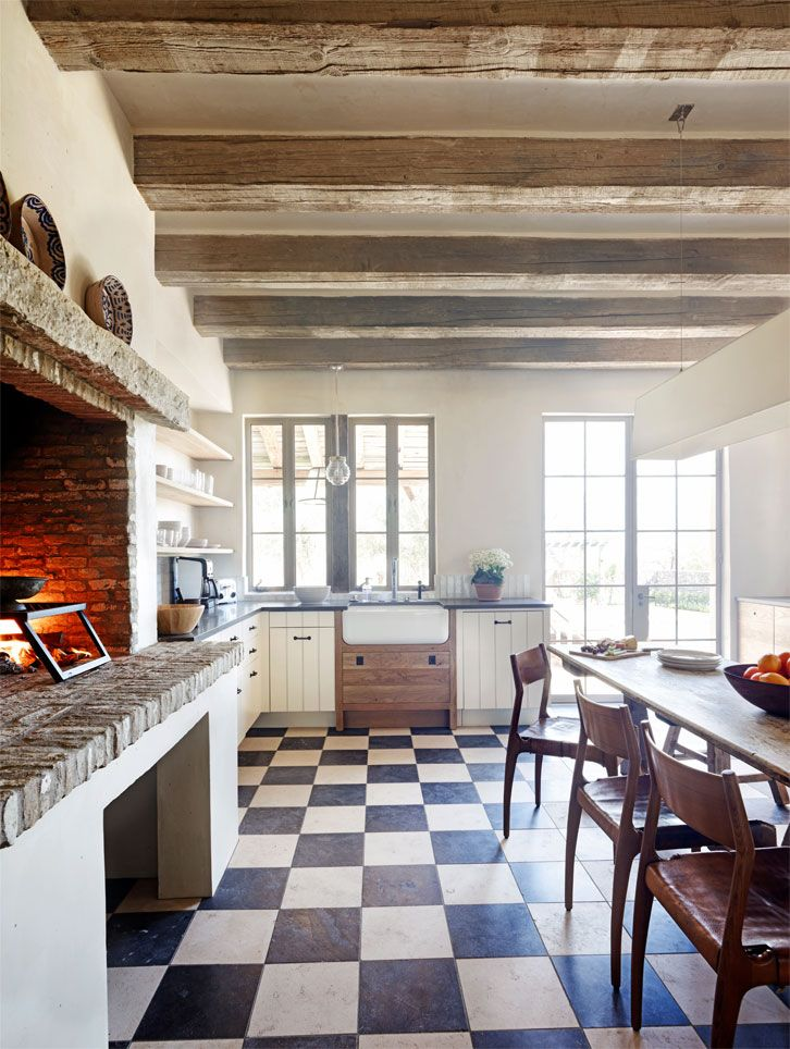 Lovely kitchen fireplace. French farmhouse in Sonoran Desert; David Michael Miller and OZ Architect.
