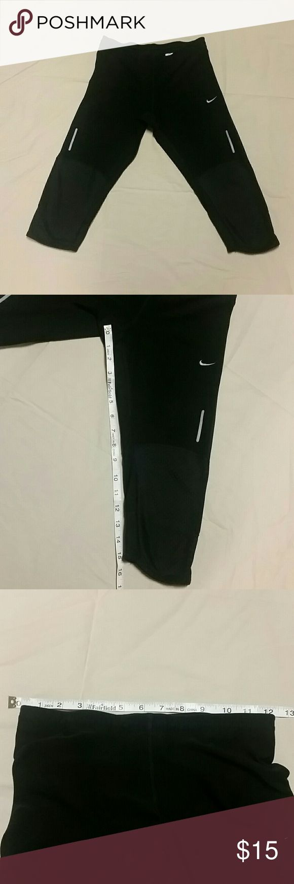 Nike dri fit running tights knee length xsmall Black Nike running tights knee length dri fit material back zip pocket mesh at back of knees, see pics for measurements, reflective strips on outside of thighs, leggings, yoga Nike Pants Track Pants & Joggers
