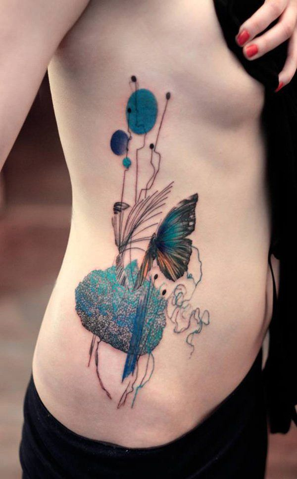 Beautiful peacock blue with butterfly side tattoo - Side tattoos are also extremely popular these days especially for women. This delicate blue peacock and butterfly design could be great designs for ladies.