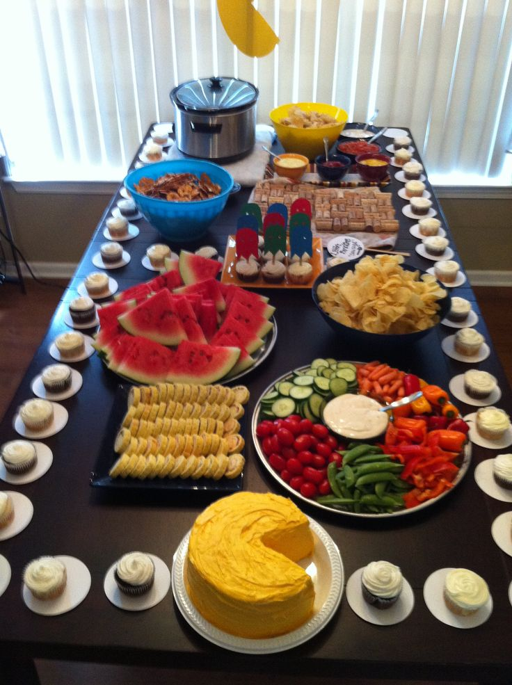 Table of finger foods mostly kid friendly but kept the
